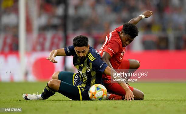 David Alaba of Muenchen challenges Mehmet Ekici of Fenerbahce during the Audi Cup 2019 semi final match between FC Bayern Muenchen and Fenerbahce at...