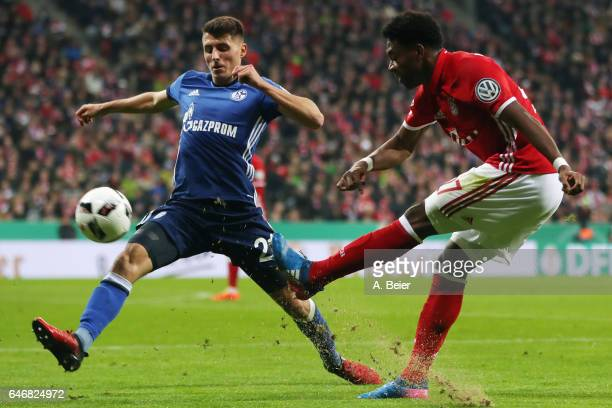 David Alaba of Muenchen is challenged by Alessandro Schoepf of Schalke during the DFB Cup quarter final between Bayern Muenchen and FC Schalke 04 at...