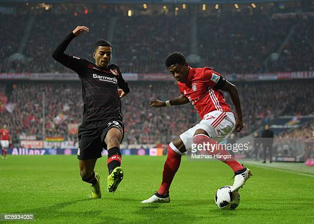 David Alaba of Muenchen is challenged by Benjamin Henrichs of Leverkusen during the Bundesliga match between Bayern Muenchen and Bayer 04 Leverkusen...