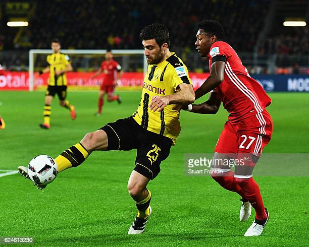 David Alaba of Muenchen is challenged by Sokratis Papastathopoulos of Dortmund during the Bundesliga match between Borussia Dortmund and Bayern...