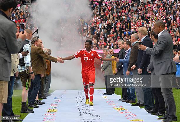 David Alaba of Muenchen is greeted by Muechen legends after the Bundesliga match between FC Bayern Muenchen and FC Augsburg at Allianz Arena on May...
