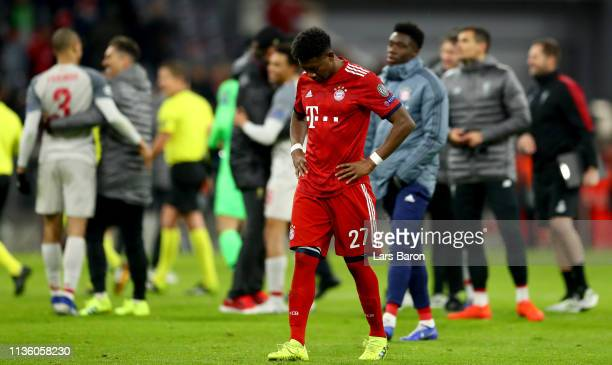 David Alaba of Muenchen looks dejeceted after loosing the UEFA Champions League Round of 16 Second Leg match between FC Bayern Muenchen and Liverpool...