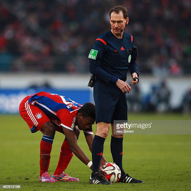 David Alaba of Muenchen places the ball for a freekick before scoring his team's second goal during the Bundesliga match between VfB Stuttgart and FC...