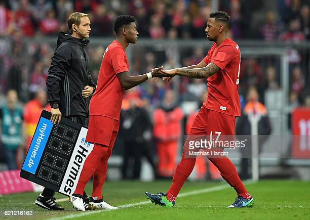 David Alaba of Muenchen replaces Jerome Boateng of Muenchen as a substitute during the Bundesliga match between Bayern Muenchen and TSG 1899...