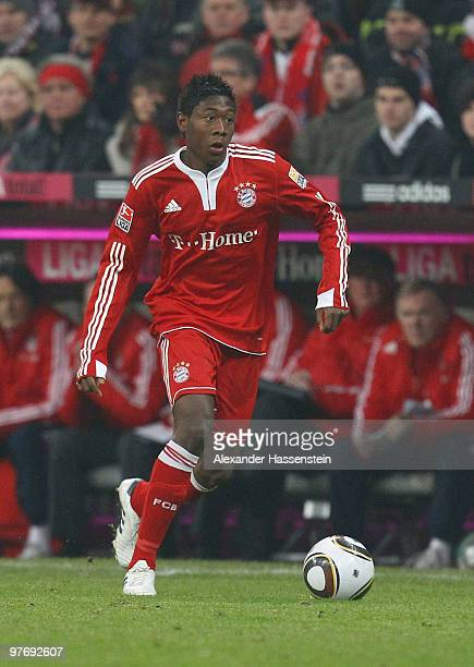 David Alaba of Muenchen runs with the ball during the Bundesliga match between FC Bayern Muenchen and SC Freiburg at Allianz Arena on March 13 2010...