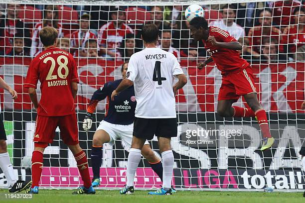 David Alaba of Muenchen scores his team's first goal against goalkeeper David during the LIGA total! Cup 3rd place match between FSV Mainz 05 and...
