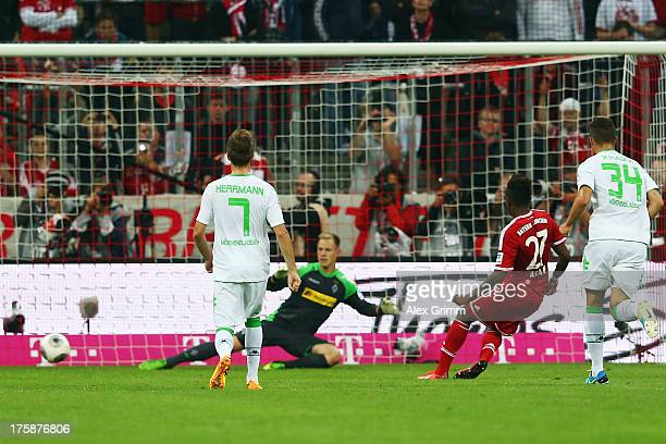 David Alaba of Muenchen scores his team's third goal with a penalty against goalkeeper MarcAndre ter Stegen of Moenchengladbach during the Bundesliga...