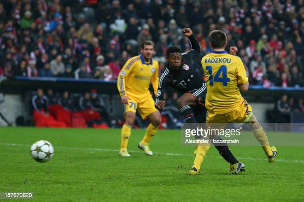 David Alaba of Muenchen scores the 4th team goal against Artem Radkov of Borisov during the UEFA Champions League Group F match between FC Bayern...