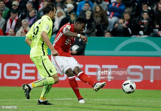 David Alaba of Muenchen scores the third goal during the DFB Cup second round match between Bayern Muenchen and FC Augsburg at Allianz Arena on...