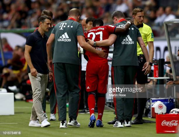 David Alaba of Muenchen walks injured off the pitch during the DFL Supercup 2018 between Eintracht Frankfurt and Bayern Muenchen at CommerzbankArena...