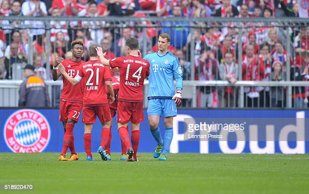 David Alaba Philipp Lahm Xabi Alonso and Manuel Neuer of Bayern Muenchen react after the Bundesliga match between FC Bayern Muenchen and Eintracht...