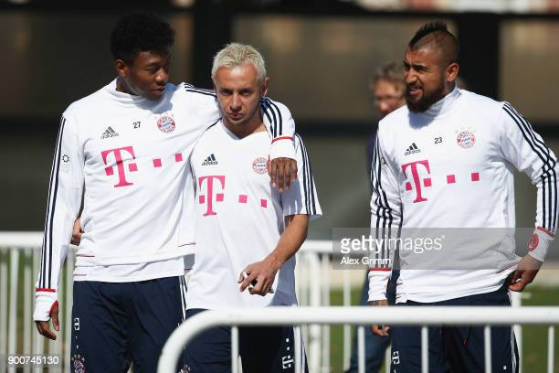 David Alaba Rafinha and Arturo Vidal arrive for a training session on day 2 of the FC Bayern Muenchen training camp at ASPIRE Academy for Sports...