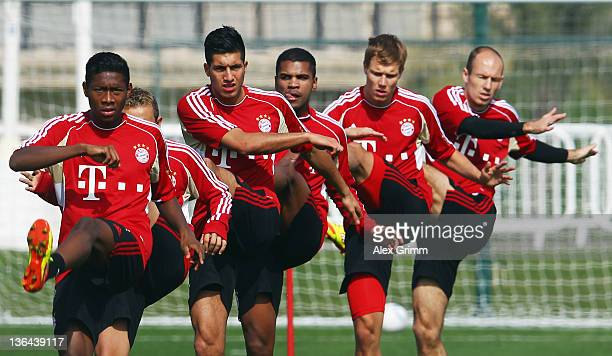David Alaba Rafinha Emre Can Breno Holger Badstuber and Arjen Robben exercise during a training session of Bayern Muenchen at the ASPIRE Academy for...