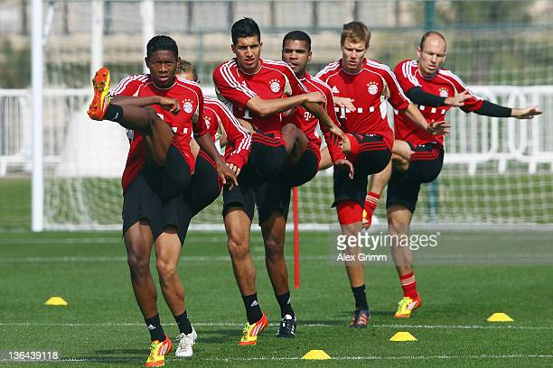 David Alaba, Rafinha, Emre Can, Breno, Holger Badstuber and Arjen Robben exercise during a training session of Bayern Muenchen at the ASPIRE Academy...