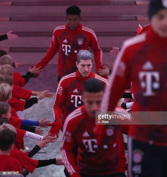 David Alaba Robert Lewandowski Corentin Tolisso and James Rodriguez of FC Bayern Muenchen are pictured with kids at the players' tunnel ahead of the...