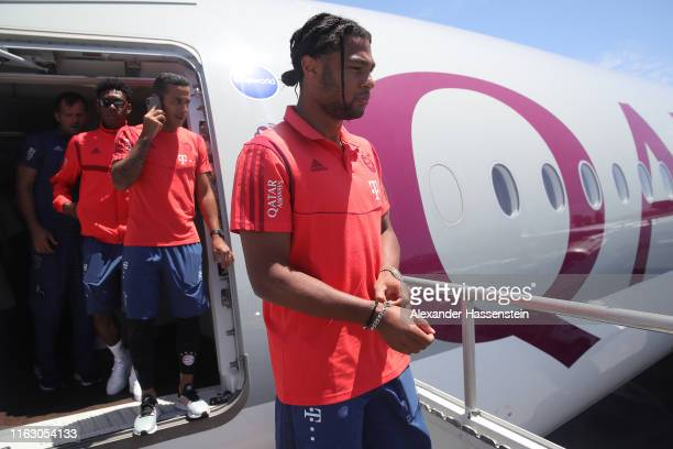 David Alaba Thiago Alcantara and Serge Gnabry of FC Bayern Muenchen look on at the Los Angeles International Airport to depart with the team flight...