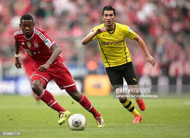 David Alaba von Bayern im Zweikampf mit Nuri Sahin von Dortmund beim BundesligaSpiel FC Bayern Muenchen gegen Borussia Dortmund am 12 April 2014 in...