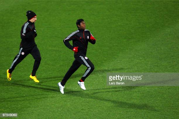David Alaba warms up next to team mate Franck Ribery during a Bayern Muenchen training session at Artemio Franchi Stadium on March 8 2010 in Florence...