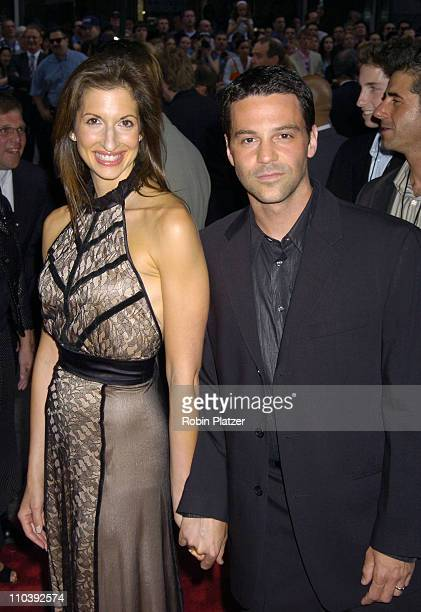 David Alan Basche and wife Alysia Reiner during War of the Worlds New York City Premiere Outside Arrivals at Ziegfield in New York City New York...