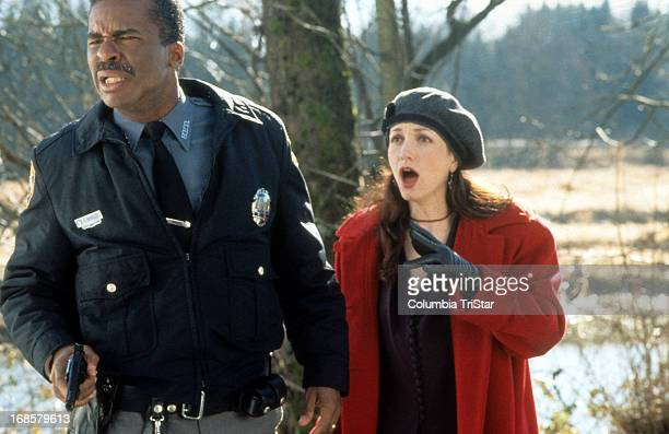 David Alan Grier and Bebe Neuwirth looking ahead in shock in a scene from the film 'Jumanji' 1995