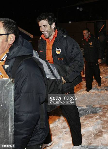 David Albelda of Valencia makes his way through the snow to get to the Abra Hall in Trondheim on November 26 2008 He and his team had an indoor...