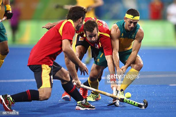 David Alegre of Spain and Jamie Dwyer of Australia compete for the ball during the men's pool A match between Brazil and Belgium on Day 2 of the Rio...