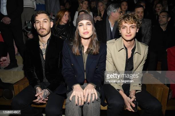 David Alexander Flinn, Charlotte Casiraghi and Vassili Schneider attend the Saint Laurent show as part of the Paris Fashion Week Womenswear...