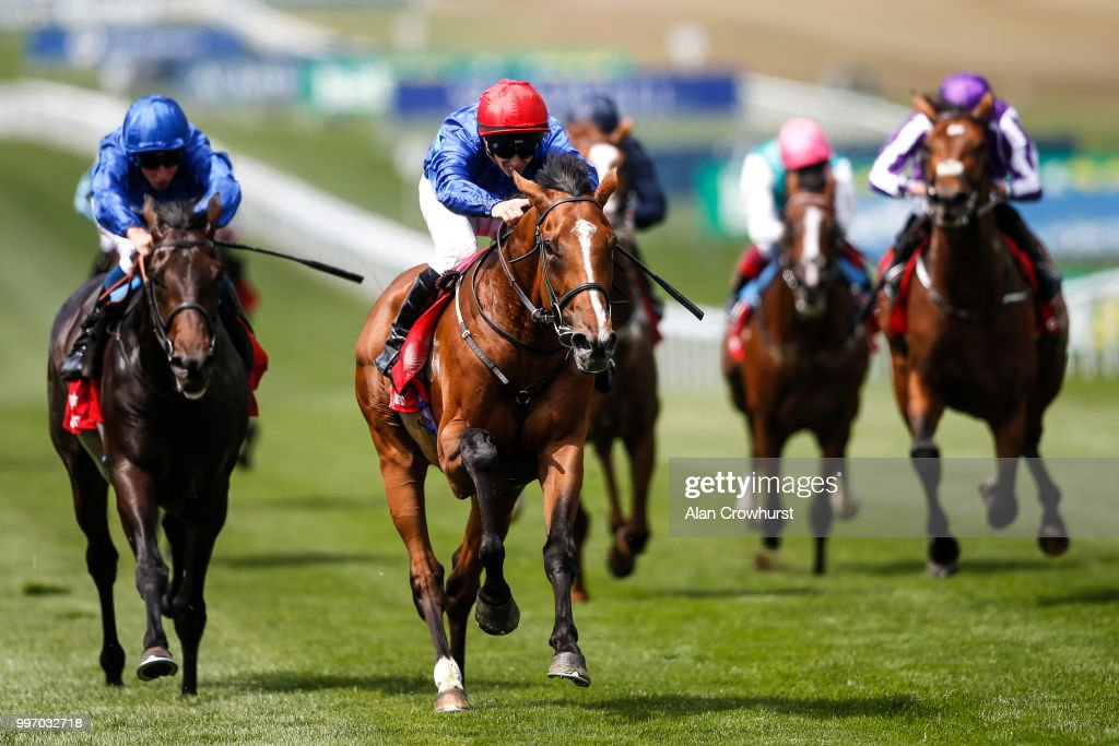 David Allan riding Wells Farhh Go (C, red cap) win The Bahrain Trophy Stakes at Newmarket Racecourse on July 12, 2018 in Newmarket, United Kingdom.