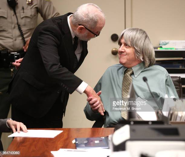 David Allen Turpin accused of abusing and holding 13 children captive shakes hands with his attorney David Macher on May 4 2018 in Riverside...