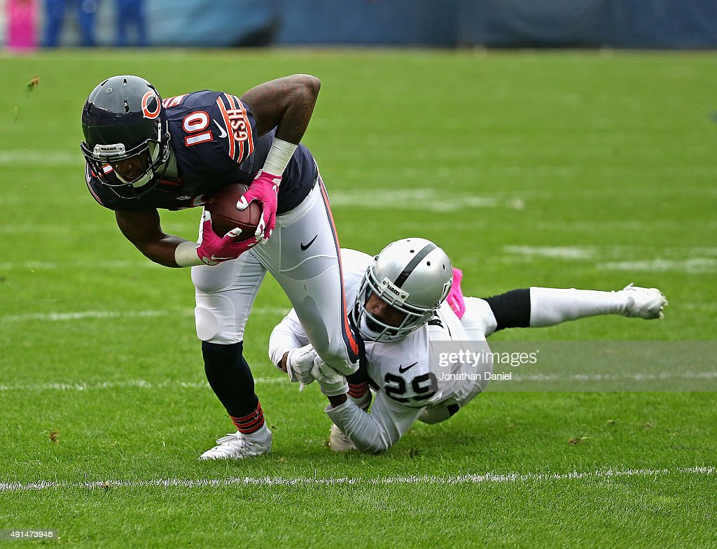 David Amerson #29 of the Oakland Raiders drags down Marquess Wilson #10 of the Chicago Bears at Soldier Field on October 4, 2015 in Chicago, Illinois. The Bears defeated the Raiders 22-20.