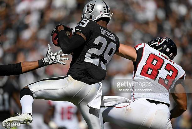 David Amerson of the Oakland Raiders intercepts a pass intended for Jacob Tamme of the Atlanta Falcons in the second half during their NFL game at...