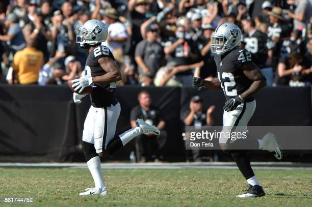 David Amerson of the Oakland Raiders runs off the field with the ball after a fumble recovery against the Los Angeles Chargers during their NFL game...