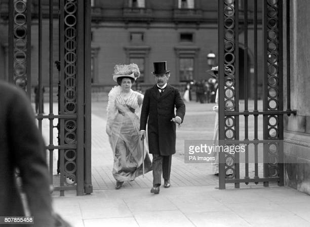 David and Margaret Lloyd George leaving a Garden Party at Buckingham Palace