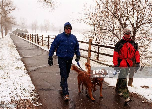 David and Ross Wyman walk thier Irish Setters Mirella and Renee' along east Quincy Ave near Kent Denver School in Cherry Hills Village David said the...