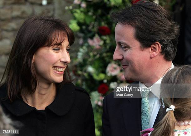 David and Samantha Cameron leave Christ Church Kensington with their daughter Nancy after attending the wedding of Alan Parker and Jane Hardman on...