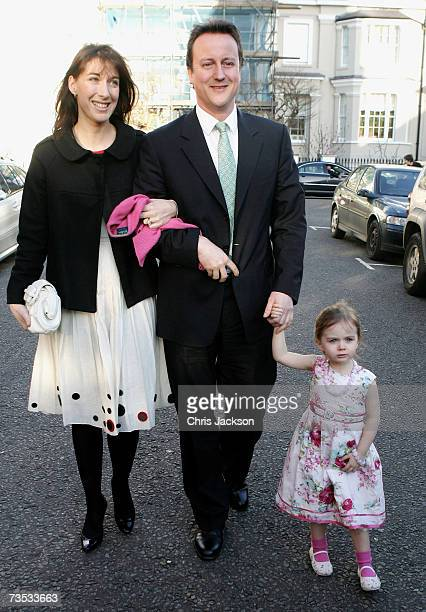 David and Samantha Cameron pose for a photograph with their daughter Nancy at Christ Church Kensington as they arrive at the wedding of Alan Parker...