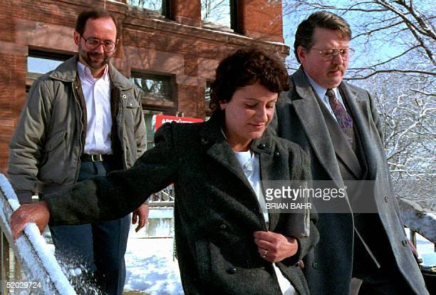 David and Sharon Schoo leave from the back door of the Kane County Courthouse 14 January, 1993 with one of their lawyers, Gerard Kepple , after a...