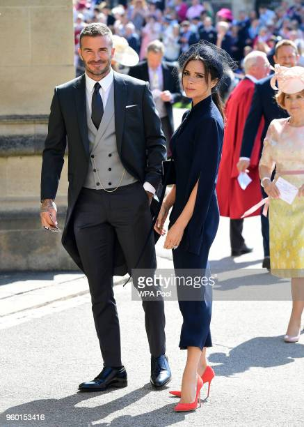 David and Victoria Beckham arrive at St George's Chapel at Windsor Castle before the wedding of Prince Harry to Meghan Markle on May 19 2018 in...