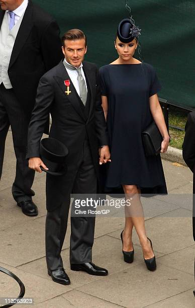 David and Victoria Beckham arrive for the Royal Wedding of Prince William to Catherine Middleton at Westminster Abbey on April 29, 2011 in London,...