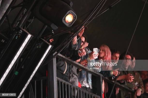 David and Victoria Beckham at the side of stage during Ed Sheeran as he performs on the Pyramid stage on day 4 of the Glastonbury Festival 2017 at...