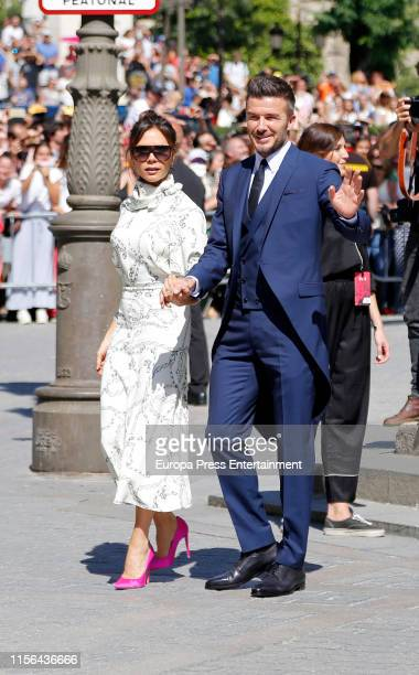 David and Victoria Beckham attend the wedding of Real Madrid football player Sergio Ramos and Tv presenter Pilar Rubio at Seville's Cathedral on June...
