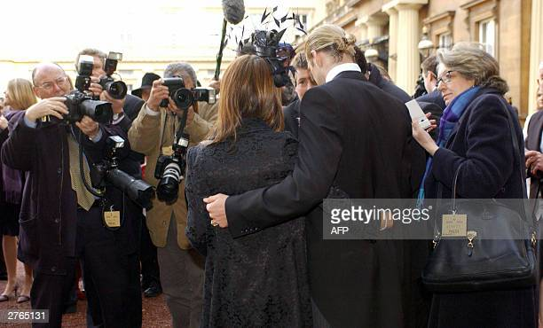 David and Victoria Beckham meet the press after the England football Captain recieved an Order of the British Empire from Britain's Queen Elizabeth...