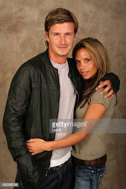 David and Victoria Beckham pose for a studio portrait backstage at 'Live 8 London' in Hyde Park on July 2 2005 in London England The free concert is...
