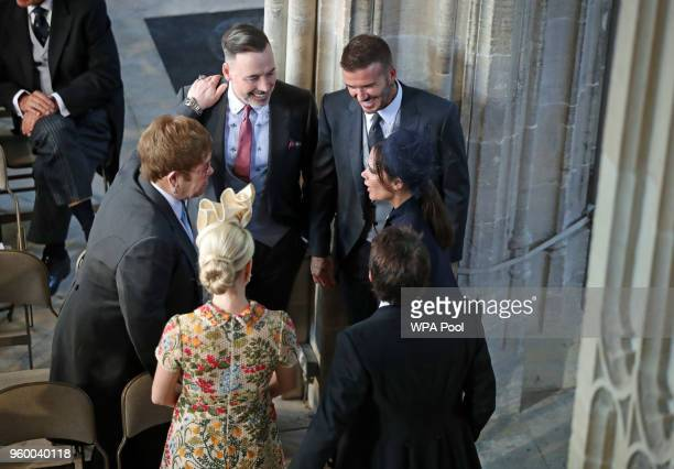 David and Victoria Beckham talk with Sir Elton John and David Furnish and Sofia Wellesley and James Blunt as they arrive in St George's Chapel at...