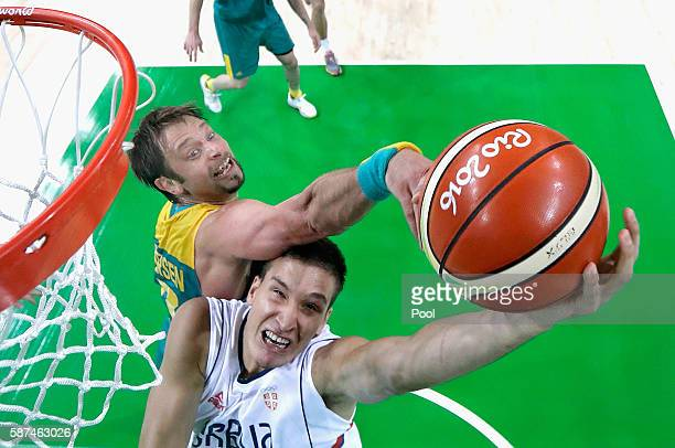 David Andersen of Australia blocks the shot of Bogdan Bogdanovic of Serbia during the Men's Basketball preliminary round Pool A game on Day 3 of the...
