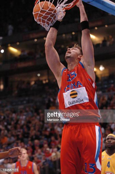 David Andersen of CSKA Moscow dunks the basketball during the NBA Europe Live Tour presented by EA Sports on October 10 2006 at the Koeln Arena in...