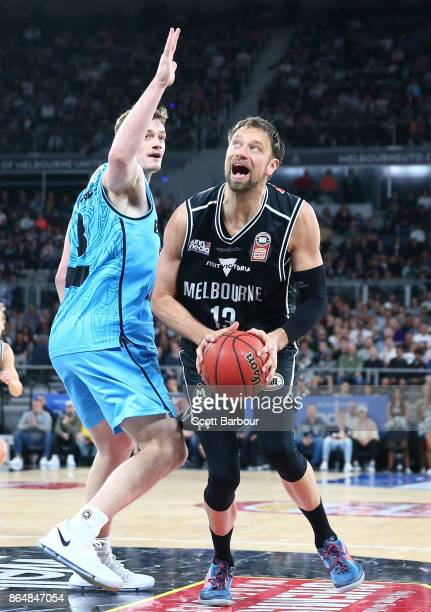 David Andersen of United controls the ball during the round three NBL match between Melbourne United and the New Zealand Breakers at Hisense Arena on...