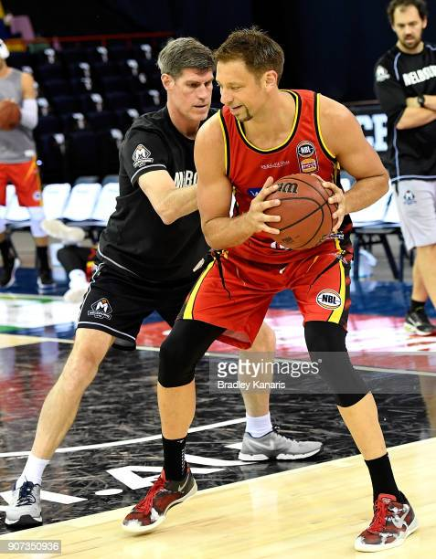 David Andersen of United is pressured by the defence during the warmups before the round 15 NBL match between the Brisbane Bullets and Melbourne...