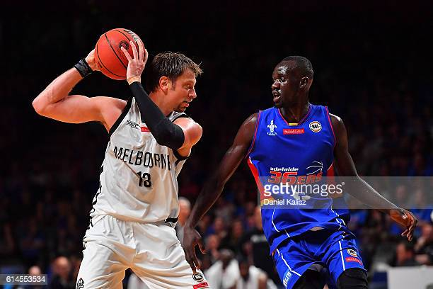 David Anderson of Melbourne United competes for the ball against Majok Deng of the Adelaide 36ers during the round two NBL match between the Adelaide...