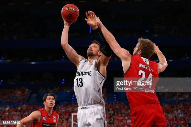 David Anderson of United puts a shot up against Jesse Wagstaff of the Wildcats during the round three NBL match between the Perth Wildcats and...